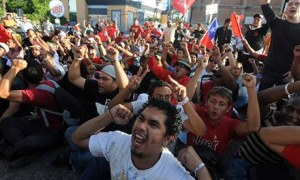 Supporters of Xiomara Castro protest in Honduras the day after general elections